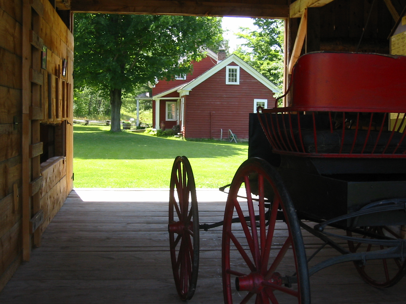 Looking at the farmhouse from inside the buggy house at the Almanzo Wilder Farm in Malone, New York