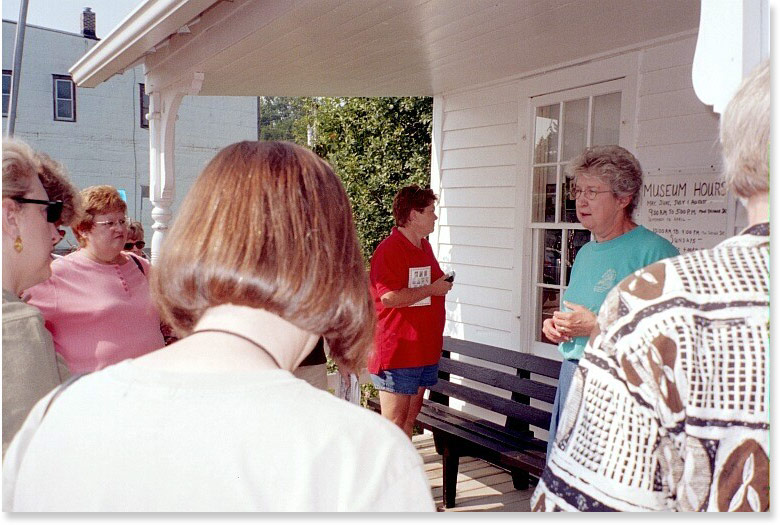 Former (and longtime) Burr Oak director Ferneva Brimacomb speaks to a tour group at the Masters Hotel in Burr Oak, Iowa.